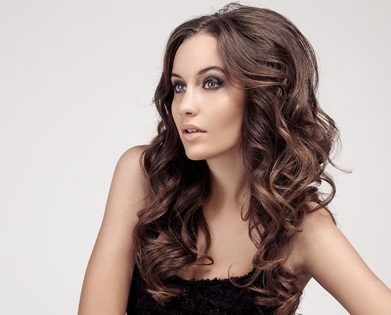 curly hair style and cut at our Destin salon